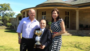Simon and Brenda Tripp with Melbourne Cup-winning jockey Ray Selkrig in 2013.