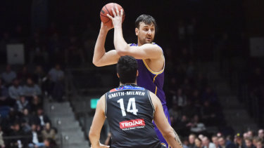 Sydney's Andrew Bogut looks to pass over Melbourne's Tohi Smith-Milner in Bendigo on Thursday.