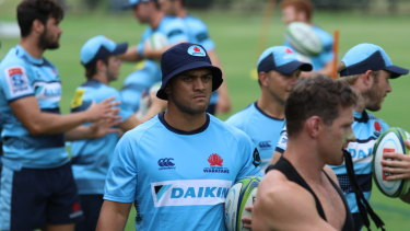 Colourful past: Karmichael Hunt (centre, dark blue hat) trains with the Waratahs during the week.