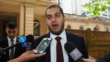 Mohamed Nizamdeen's lawyer, Moustafa Kheir, speaks to reporters outside the Sydney Central Local Court on Friday.