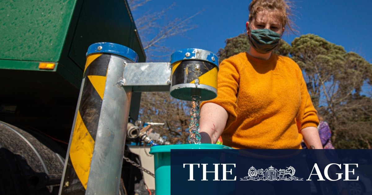 Residents filling up bottles pots and pans from water tankers over contamination fears – The Age