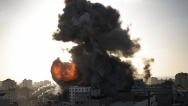 Smoke and fire rises following Israeli airstrikes on a building in Gaza City on Wednesday.