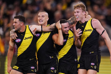 Jack Graham, Dustin Martin, Daniel Rioli and Tom Lynch celebrate the win.