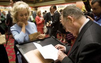 Blanche D'Alpuget gets a book signed by Graham Freudenberg in 2008.