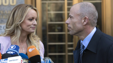 Stormy Daniels, left, stands with her lawyer Michael Avenatti outside court in April.