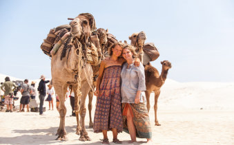 """Actress Mia Wasikowska and author Robyn Davidson on set of the film adaptation of Davidson's """"life-defining"""" book, Tracks."""
