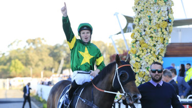 Tommy Berry  celebrates as Ole Kirk returns to to scale.