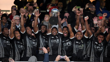 Frank Lomani of Fiji lifts the Killik Cup, the trophy awarded to the winner of matches between the invitational side and national teams.