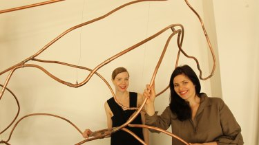 Bianca Spender (at left) and Highfield with her horse sculpture in Spender's Paddington boutique.