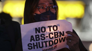 Another battle for press freedom: protester holds a banner during a rally in metropolitan Manila, Philippines.