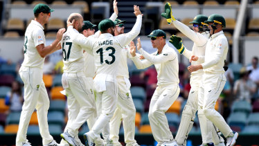 Nathan Lyon and Australia celebrate the wicket of Babar Azam on day four at the Gabba.
