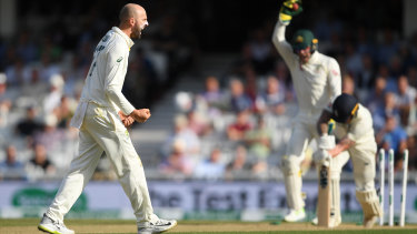 Nathan Lyon of Australia celebrates taking the wicket of Ben Stokes of England in a heated third day's action.