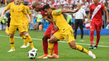 Sensation: Daniel Arzani is tackled by Andre Carrillo of Peru in Sochi.