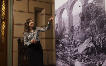 Dr Penny Stannard, senior curator at the NSW State Archives, with an image of Picton Viaduct from the Queen's Album from the late 1800s.