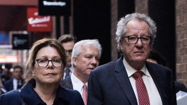 Geoffrey Rush and his wife Jane Menelaus leave the Federal Court in Sydney after his defamation win.
