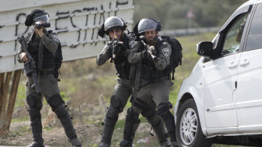 Israeli security forces take position during clashes with Palestinians after a demonstration against the arrest of members of Fatah in Jerusalem by the Israeli authorities, at Hawara checkpoint near the West Bank city of Nablus, on Sunday.