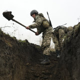 Ukrainian soldiers dig trenches at a position near the front line with Russia-backed separatists in Shyrokyne, eastern Ukraine.
