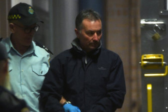 John Michael Fitzgerald is escorted to a prison van at Burwood Courthouse in Sydney.