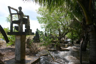 A king tide erodes a graveyard in the Torres Strait.