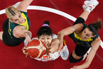Busy action under the basket between the Opals and China.