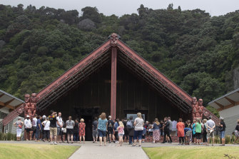 People gather at a community centre in the mainland town of Whakatane, near White Island, to mourn those lost.