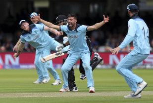 England's Mark Wood celebrates the dismissal of New Zealand's Ross Taylor.