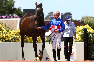 Glen Boss and Makybe Diva commemorate the legendary mare's three Cup wins at Flemington on Tuesday.