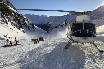 Rescuers at work following the avalanche in Val Senales that killed a woman and a two children. An Alpine rescue corps spokesman says helicopters are searching for any other possible victims.
