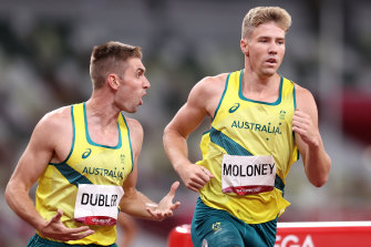 Cedric Dubler giving Ash Moloney the encouragement he needed in the last event of the decathlon at the Tokyo Olympics.