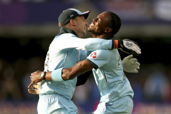 Jofra Archer (right) celebrates England's World Cup win with Jos Buttler.