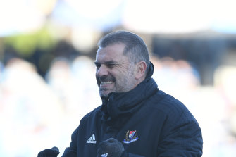 Ange Postecoglou celebrates as Yokohama F. Marinos clinch the title.