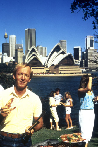 """Paul Hogan with a prawn in the 1984 Tourism Australia campaign """"Come and say G'day""""."""