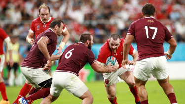 Georgia players defend their line against Wales.