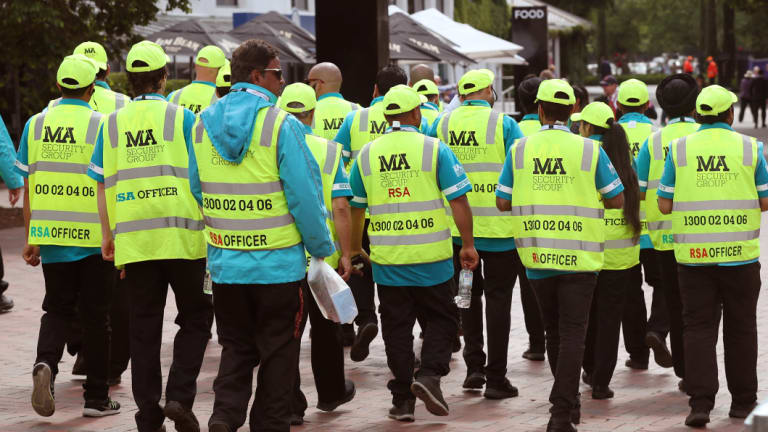 Private security has descended in numbers on Flemington Racecourse