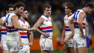 Jack Macrae (centre) and his dejected teammates after the big loss to the Eagles.