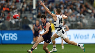 Caught short: Andrew Brayshaw of the Dockers kicks past Joel Selwood of the Cats.