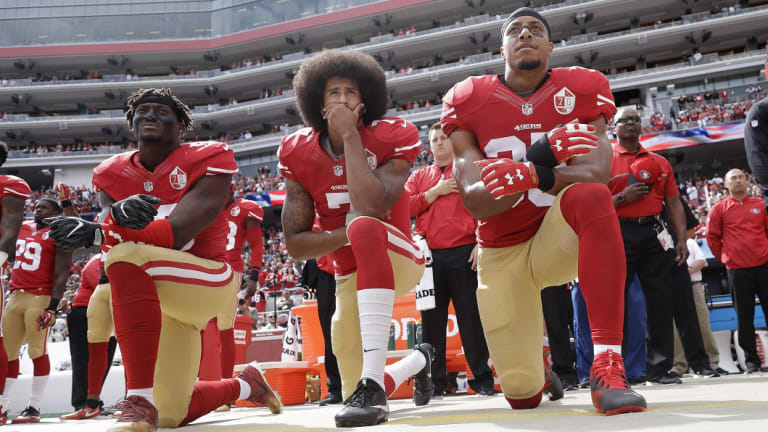 Game-changer: San Francisco 49ers' Eli Harold (from left), Colin Kaepernick and Eric Reid kneel during the national anthem before facing the Dallas Cowboys in October 2016.