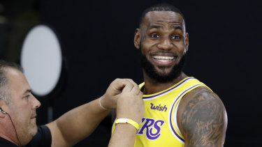 All smiles: LeBron has taken over the Lakers, but who will replace him as king in the East?