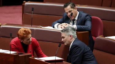 Mathias Cormann speaks with Pauline Hanson and Peter Georgiou in the Senate on Monday.