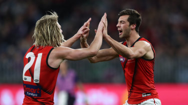 Kyle Langford and Dyson Heppell celebrate a goal in Essendon's finals-sealing win.