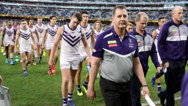 Ugly incident: Fremantle coach Ross Lyon leads his team off the field after loss to West Coast that was blighted by Andrew Gaff's hit on young Docker Andrew Brayshaw.