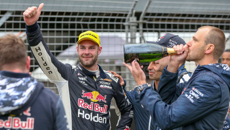Toast: Shane van Gisbergen (second left) and his team celebrate victory in Auckland.