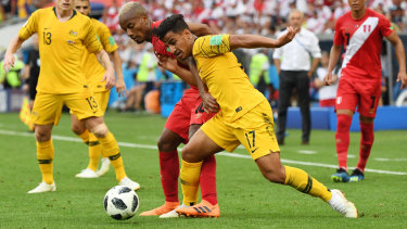 Sensation: Daniel Arzani is tackled by Andre Carrillo of Peru in Sochi.