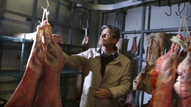Butcher and Providore Grant Hilliard handles lamb in his Marrickville retail store.