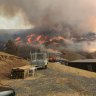 Several Queensland schools to close on Monday as Trad warns of fire threat