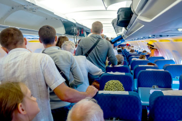 Moscow, Russia - June 15, 2016:  Passengers expect exit the aircraft after landing Flight Simferopol-Moscow iStock image for Traveller. Re-use permitted. Plane passengers boarding