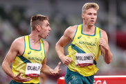 Ash Moloney is encouraged by teammate Cedric Dubler in the last event of the decathlon.