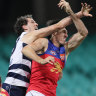 Darcy Fort (left) tussles with Oscar McInerney (right).