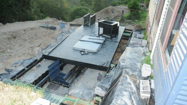 The deck at the Elands property which has partially moved away to show a trapdoor, which led to three buried shipping containers where a large hydroponic cannabis set up was discovered.