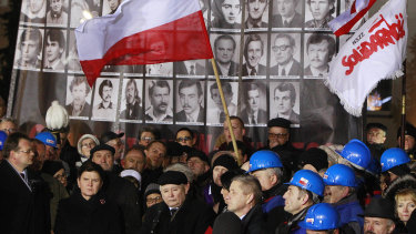 Jaroslaw Kaczynski, centre, speaks during the demonstration organised by Polish party Law and Justice on the 35th anniversary of the introduction of martial law at Three Crosses Square, in Warsaw, Poland, in 2016.